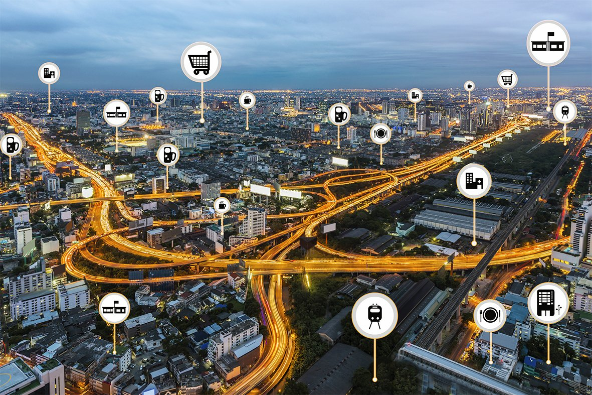 Smart city things icons mesh on city traffic night background  and wireless communication network, business district with expressway and highway. (Business and Internet concept)